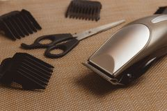 Stylish Professional Hair Clippers, accessories on brown background Royalty Free Stock Image