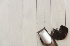 Stylish Professional Hair Clippers, accessories on wood background copy space Stock Photography