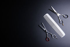 Stylish Professional Barber Scissors and white comb on black background. Hairdresser salon concept, Hairdressing Set. Haircut. Accessories. Copy space image stock images