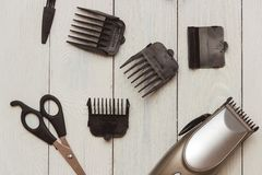 Stylish Professional Hair Clippers, accessories on wood background Stock Photography