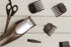 Stylish Professional Hair Clippers, accessories on wood background Stock Photos