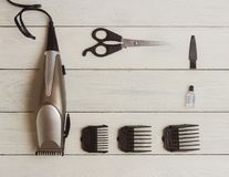 Stylish Professional Hair Clippers, accessories on wood background copy space Royalty Free Stock Photos