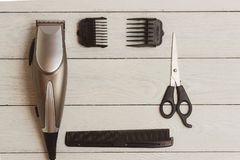 Stylish Professional Hair Clippers, accessories on wood background copy space Royalty Free Stock Image