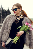 Stylish red hair girl with pink tulips Royalty Free Stock Image