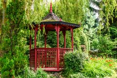 Red pagoda in the garden Stock Photos