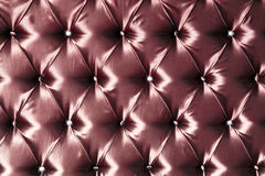 Stylish red silk upholstery. As backround Stock Photos