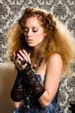 Stylish redheaded model with apple Stock Images