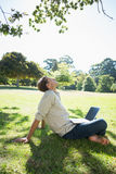 Stylish relaxed man using his laptop in the park Royalty Free Stock Images