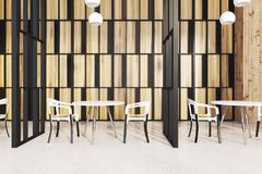 Stylish restaurant interior, wooden walls Royalty Free Stock Images