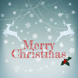 Stylish retro Christmas card. / with deers and Merry Christmas  greeting text Royalty Free Stock Photos