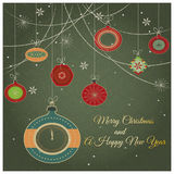 Stylish retro Christmas ornaments. With Merry Christmas and Happy New year greeting text and fancy clock Royalty Free Stock Photo