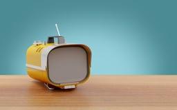 Stylish retro TV sixties. Stylish orange retro TV mobile sixties, on a table Royalty Free Stock Photos