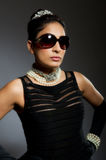 Stylish retro young woman with sunglasses Royalty Free Stock Photo