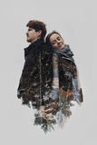 Stylish romantic couple in double exposure with tree branches in. Park. sensual atmospheric moment with space for text. men embraving gently hugging woman Royalty Free Stock Photo