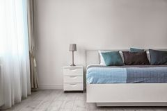 Stylish room interior with   bed. Stylish room interior with comfortable bed Stock Photography