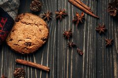 Stylish rustic winter flat lay with cookie anise cinnamon and pi Stock Photo