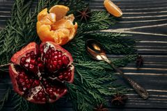 Stylish rustic winter flat lay with garnet oranges and spices on Royalty Free Stock Image