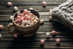 Stylish rustic winter wallpaper of cup with colorful marshmallow Royalty Free Stock Image
