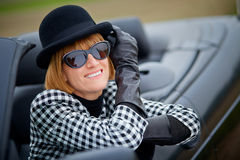 Stylish 40s woman happy with new Convertible Royalty Free Stock Images