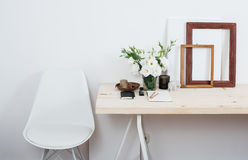 Stylish scandinavian interior design, white workspace. With desk and chair, trendy artist studio decor stock image