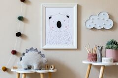 Playroom for kids with cute toys and mockup poster frame in Scandinavian style.