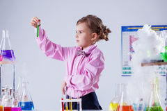 Stylish schoolgirl posing in chemistry lab Stock Images