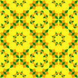 Stylish seamless pattern of orange and green shades geometrical objects on yellow background Royalty Free Stock Photography