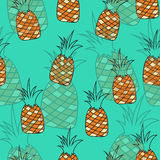 Stylish seamless pattern of pineapples on turquoise background. Royalty Free Stock Photo