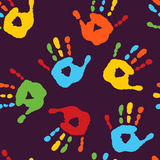 Stylish seamless pattern with prints of children`s hands Royalty Free Stock Photo