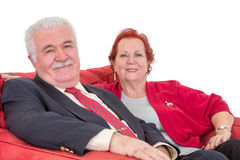 Stylish senior couple in red Royalty Free Stock Photos