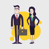 Stylish serious businessman with leather briefcase and elegant slim businesswoman. Royalty Free Stock Photography