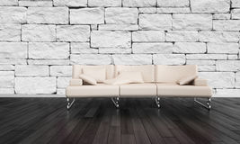 Stylish settee in a rustic stone accented room Royalty Free Stock Photos