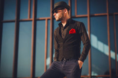 Stylish sexy handsome man in in fashionable clothes lifestyle in Royalty Free Stock Photo