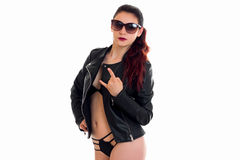 Stylish sexy young brunette in a black leather jacket and sunglasses. Isolated on white background Stock Photography