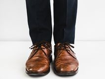 Stylish shoes and blue trousers. On a white background Stock Images