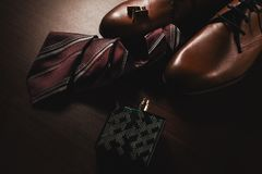 Stylish shoes with tie and perfume. Men`s accessories. Stylish shoes with tie and perfume Stock Image