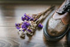 Stylish shoes, wildflowers Stock Photos