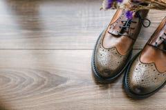 Stylish shoes, wildflowers Royalty Free Stock Photo