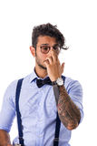 Stylish shy hipster in glasses Stock Photo