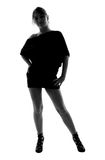 Stylish silhouette of Caucasian woman posing Stock Photography