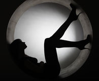 Stylish silhouette  woman in circle Stock Photos