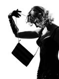 Stylish silhouette woman sexy with purse Royalty Free Stock Photography