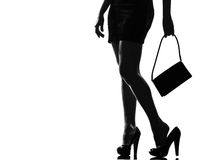 Stylish silhouette woman tired painful feet Royalty Free Stock Image