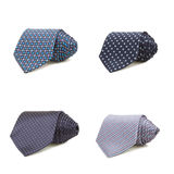 Stylish silk male tie ( necktie ) on white. Some stylish silk male tie (necktie) on white curled up into a coil royalty free stock photos