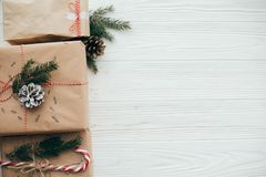 Stylish simple christmas presents with red ribbon, candy cane, p royalty free stock photo