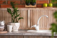 Stylish sink and faucet in modern kitchen. Idea for home design royalty free stock image
