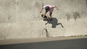 Stylish skateboarder doing skateboard trick on old wall.  stock video footage