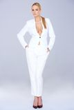 Stylish slender woman in a white slack suit Royalty Free Stock Images