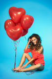 Stylish, smiling, beautiful woman with balloons over blue background Stock Image