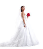Stylish smiling bride posing with red bouquet Royalty Free Stock Image